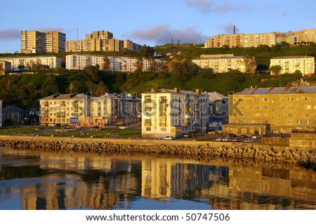 Seaside city in the summer evening before a sunset. The city of Kholmsk, island Sakhalin - stock photo