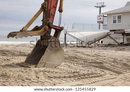 SEASIDE HEIGHTS, NJ - JAN 13: The bucket of a backhoe in the sand on January 13, 2013 in Seaside Heights, New Jersey. Clean up continues 75 days after Hurricane Sandy struck the shore in October 2012.