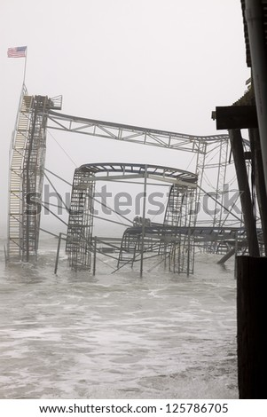 SEASIDE HEIGHTS, NJ - JAN 13: The Casino Pier Star Jet roller coaster submerged in the sea on January 13, 2013 in Seaside Heights, NJ. Clean up continues 75 days after Hurricane Sandy struck in 2012. - stock photo