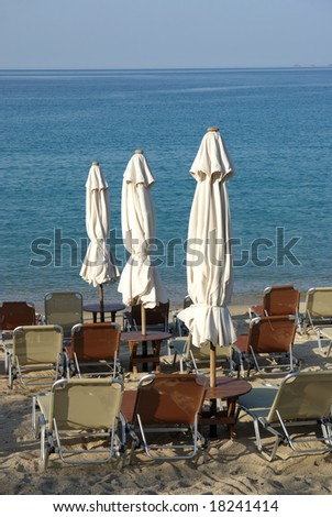 Seaside in Greece in early summer with umbrella and chairs