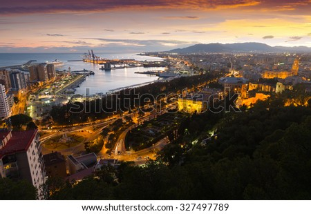 seaside part of Malaga with Port from castle in  evening time. Spain - stock photo