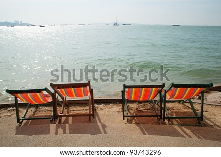 Seaside resort with a chair on the beach. Looking forward to the sea and sky.
