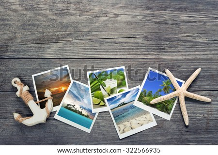seaside snapshots, anchor and starfish on wooden background - stock photo