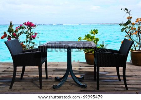 Seaside table on the beach at maldive. - stock photo