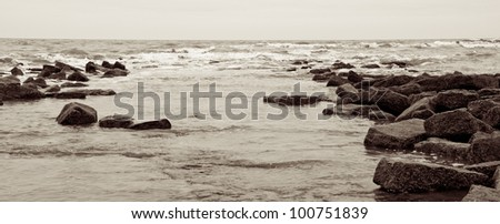 Seaside view with breakwaters - stock photo