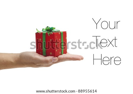 Season of giving, female hand holding gift box, isolated on white, copy space - stock photo
