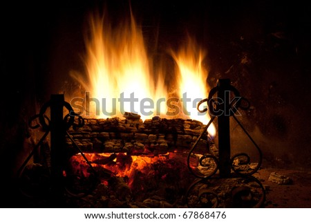 Seasonal and holiday - Fire in the fireplace. - stock photo