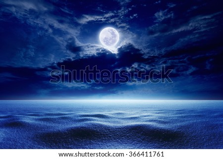 Seasonal background - cold night sky with full moon, winter weather with snow. Elements of this image furnished by NASA - stock photo