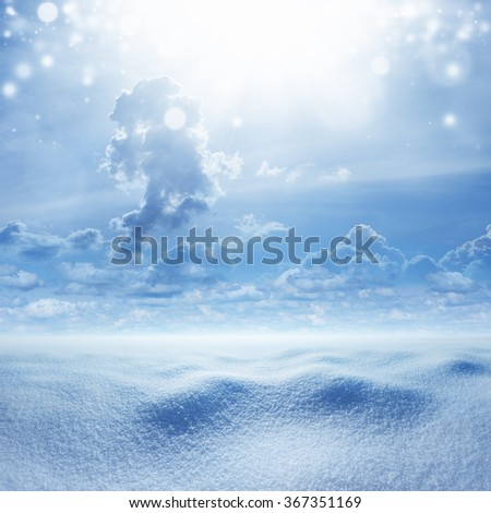 Seasonal background - snowy landscape, cold weather with snow, bright sunshine in blue sky - stock photo