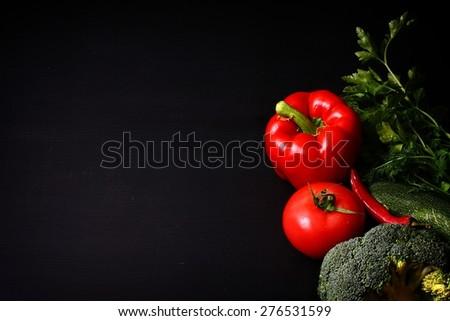 Seasonal black table with vegetables - stock photo