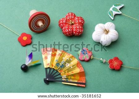 SEASONAL IMAGE-a Japanese traditional decorations ; a fan, a top, some flower ornaments and a shuttlecock - stock photo