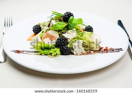 Seasonal leaf salad with Gorgonzola and blackberries - stock photo