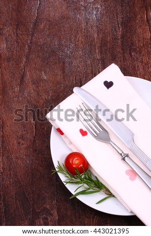 Seasonal old brown wooden table with cutlery  - stock photo