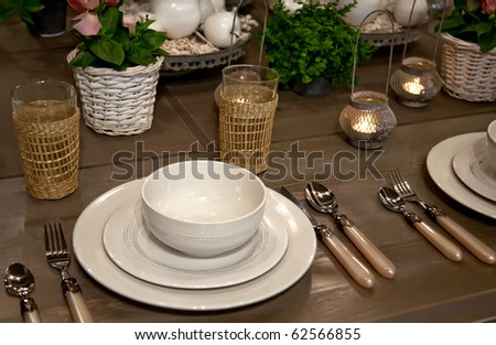 seasonal table decorated candles and apples - stock photo