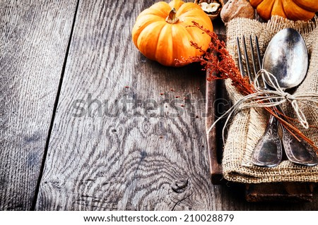 Seasonal table setting with small pumpkins  - stock photo