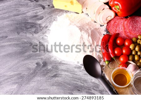 Seasonal  table with products for pizza - stock photo