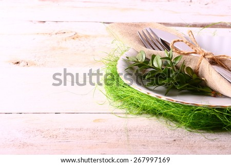 seasonal white table with cutlery - stock photo