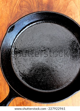 Seasoned cast iron skillet - stock photo