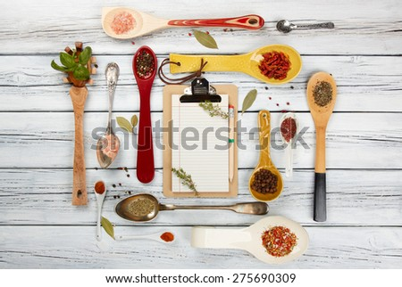 seasonings and spices in the spoons on wooden table - stock photo