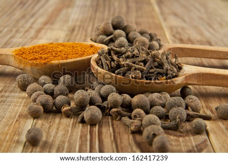 seasonings on the wooden table - stock photo
