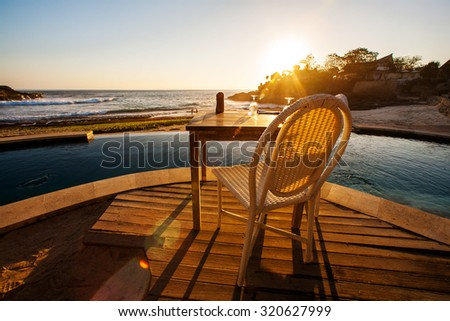 seat at beach with sunset view - stock photo