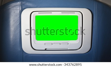Seat back airplane television chroma key green screen.  Sized to video 4K 4096 x 2304 dimension.   - stock photo