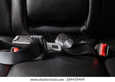 Seat belt on a black leather