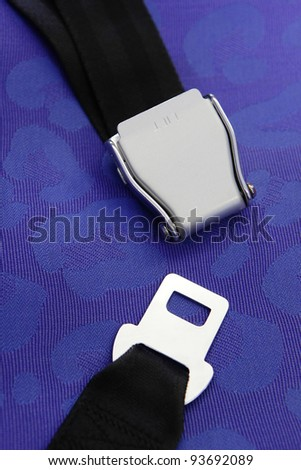 seat belt with blue background shot in airplane - stock photo