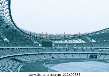 Seat grandstand blue watch the games inside the stadium. - stock photo