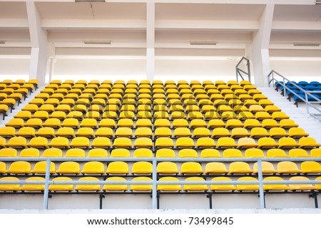 Seat grandstand yellow watch the games inside the stadium. - stock photo