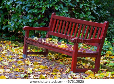 seat in a park in autumn - stock photo