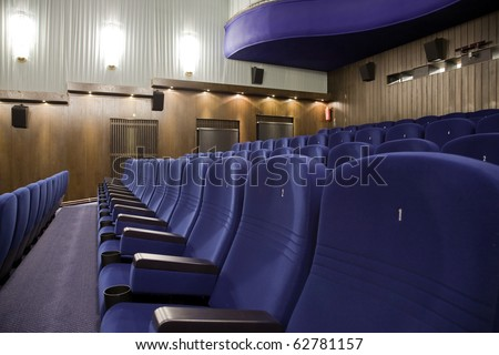 Seat #1 in line of of cinema auditorium chairs.