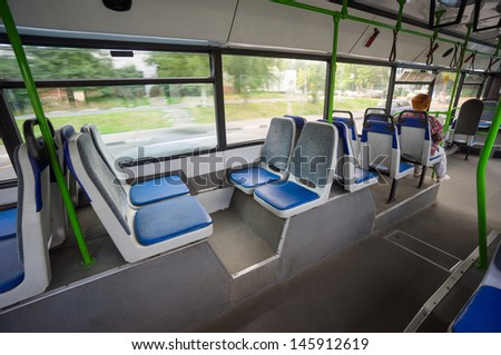 Seat places in back side of modern city bus. Wide angle shot - stock photo