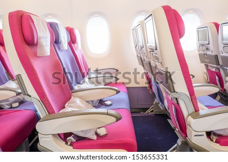 seat rows in an airplane cabin - stock photo