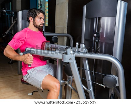 Seated back row machine man workout exercise at gym - stock photo