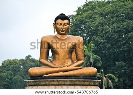 Seated Buddha at the entrance to Viharamahadevi Park in Colombo, Sri Lanka