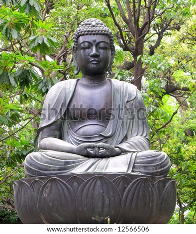 Seated Buddha statue at temple in Tokyo, Japan. - stock photo