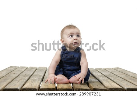 Seated little baby boy in cover all - stock photo