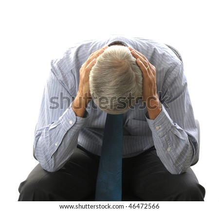 Seated Middle Aged Businessman Doubled Over with His Head in Hands isolated on white - stock photo