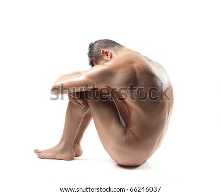 Seated naked man - stock photo