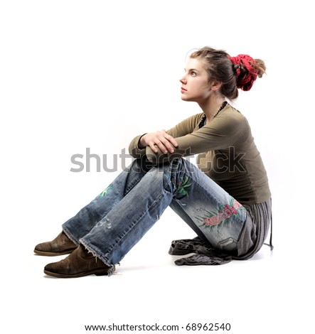 Seated woman wearing alternative clothes - stock photo