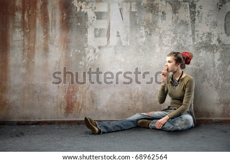 Seated woman wearing alternative clothes on a street
