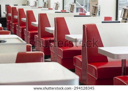 seating booth details in american diner restaurant, shallow DOPF - stock photo