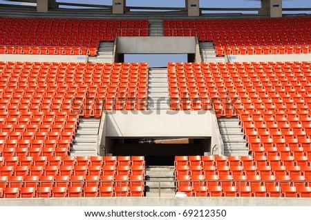 Seats at stadium  entrance walk way - stock photo