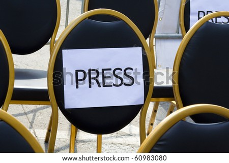 seats for the press - stock photo