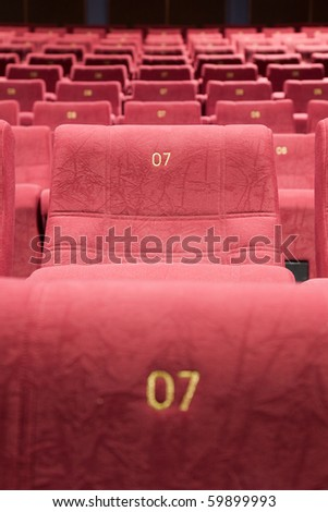 Seats #7 in interior of cinema auditorium. - stock photo
