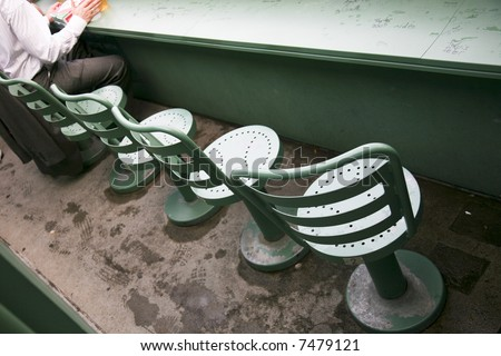Seats in the Green Monster area of Fenway Park baseball stadium in Boston - stock photo