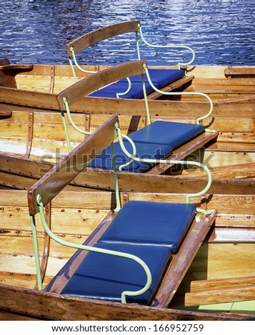 seats of old wooden rowboats