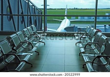seats on airport hall - stock photo