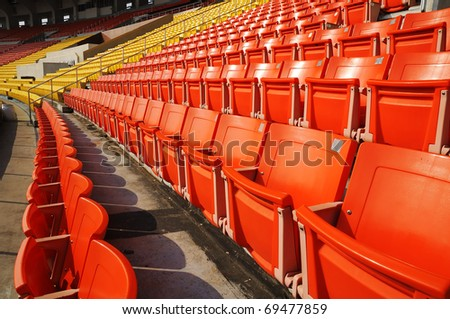 Seats red yellow at stadium  on holiday - stock photo